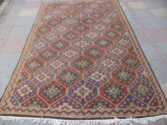 THIS BEAUTIFUL VINTAGE HANDWOVEN DIAMOND DESING KILIM RUG,THE KILIM RUG APPROXIMATELY 80 YEARS OLD IT IS HANDMADE OF VERY GOOD QUALITY IN ALL NATURAL DYES IT HAS BEEN PROFESSIONALY CLEANED AND IS READY FOR USE.  SIZE ; 75,9 X 119,6 ( 193 CM X 304 CM )  WORLD WIDE SHIPPING VIA DHL WILL INFORM TRACKING NUMBER RETURN 10 DAYS MONEY BACK BUYER PAYS RETURN SHIPPING THANK YOU SO MUCH FOR VISIT MY ETSY SHOP