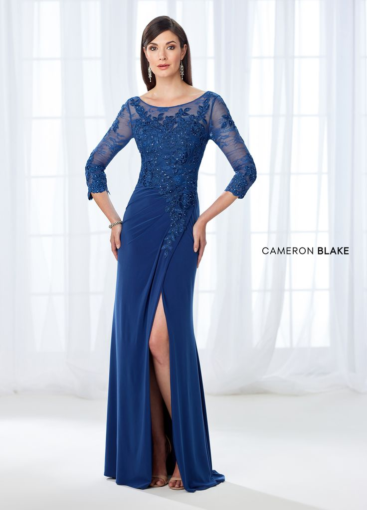 Cameron Blake 118669 - Alluring and sophisticated, this jersey fit and flare gown accented lace appliqués and heat set stones offers illusion lace three-quarter sleeves and a bateau neckline, a sweetheart bodice covered in lace that tapers off down to the side front slit and center back, an illusion lace V-back, and a side draped skirt with a sweep train.