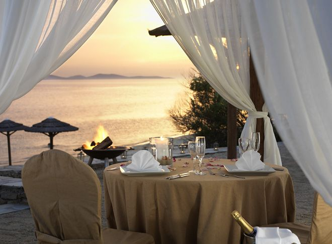 Dinner on the beach at the Mykonos Grand 5 Star Luxury Resort & Hotel: A romantic evening spent on the beach is possible. Listen to the cascading waves in the glow of a warming bonfire. Your private table and bonfire is available for those special occasions.
