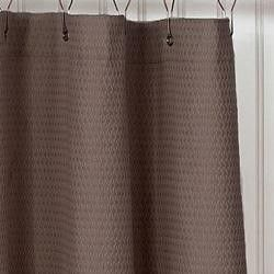A taupe shower curtain.
