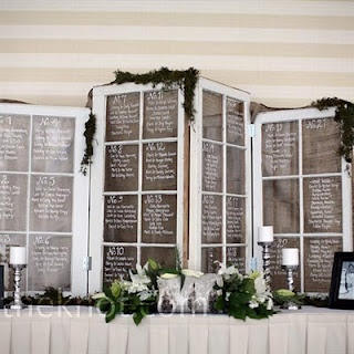 Reused windows to display seating arrangements at wedding