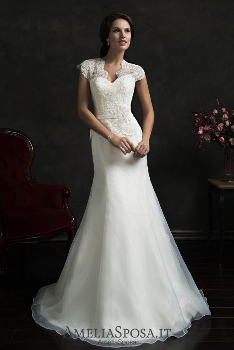 """Cap sleeve Wedding dress Senza - AmeliaSposa. Timeless classic look that is always in fashion. The elegant clinging silhouette delicately demonstrates all feminine lines forming an ideal """"guitar."""" Pure design is concentrated on the lace allowing you to enjoy its unbelievable beauty."""