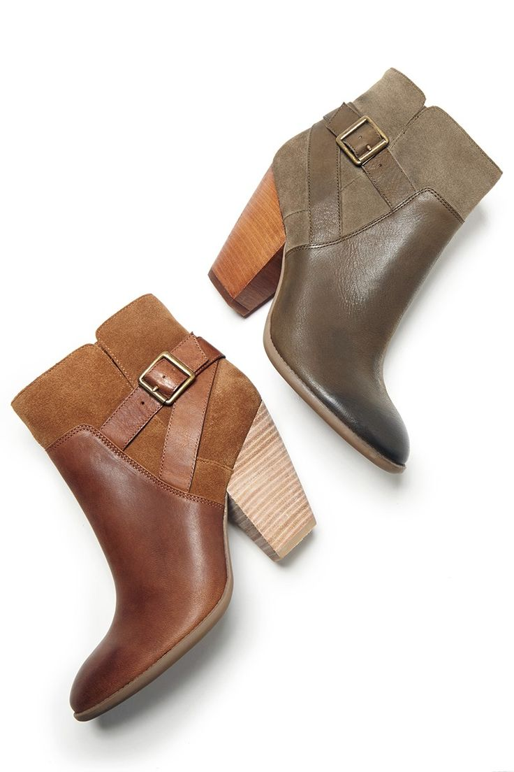 Leather & suede booties with a stacked heel and a cool side buckle - perfect with every look.: