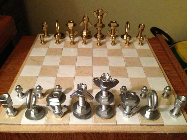 Here's an easy DIY project-- Use bolts and washers from the hardware aisle to make chess pieces.