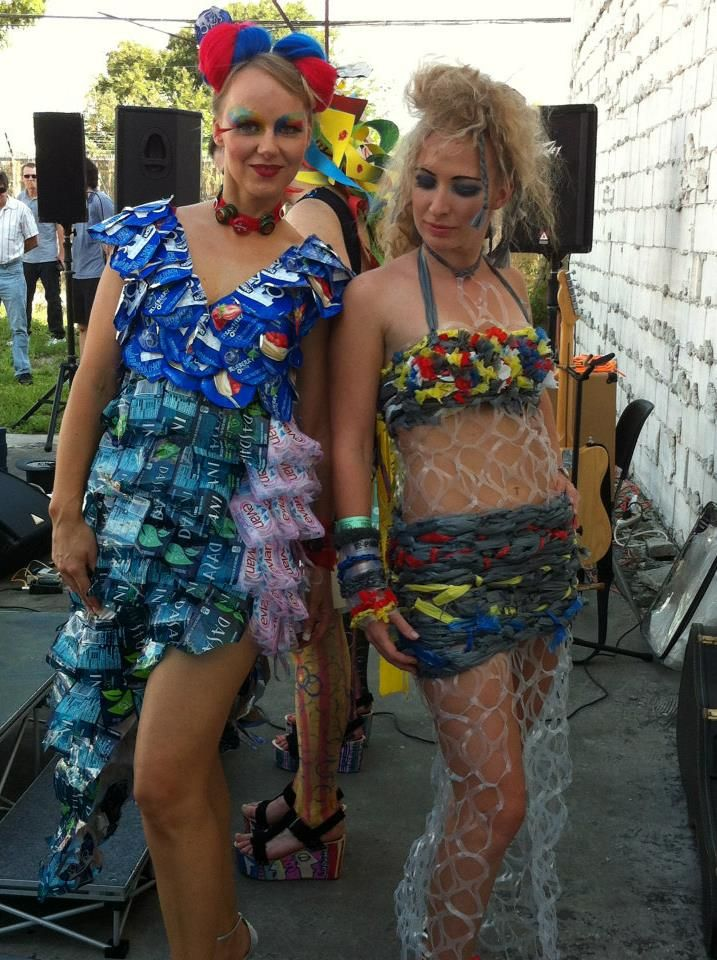 Fashions created by Artist Sue Woodall for the Art Pool Fashion show in St Pete 2012 Dress on the left is constructed from recycled Dasani & Evian water bottle labels and Dannon yogurt foil tops. The labels created a color block pattern. The dress on the right is constructed of soda bottle rings and plastic bags.