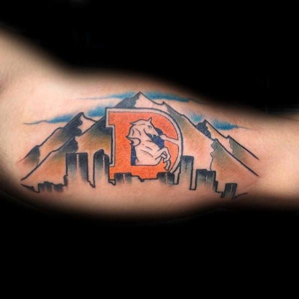 Denver Skyline with mountains and Old Broncos D