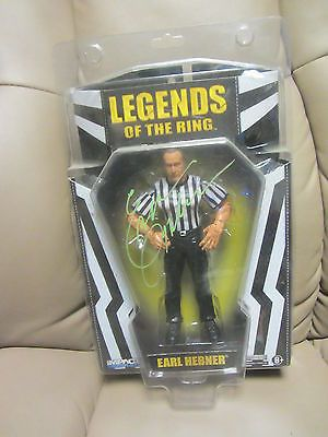 Autographed TNA Legends of the Ring Earl Hebner WWF wrestling figure Signed