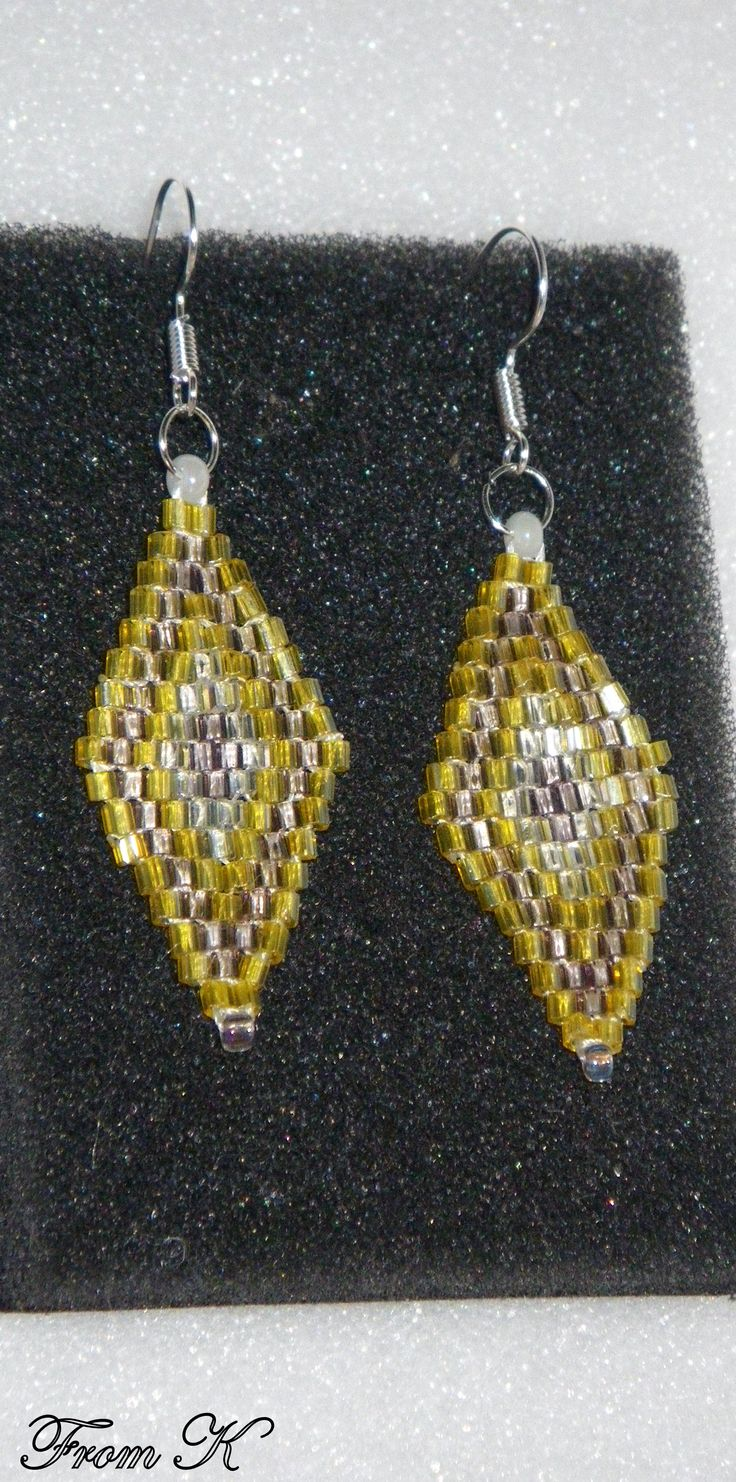 """#Diamond Shaped #Earrings. The diamond shape and color is a perfect match for that special outfit. They will """"take life"""" and shimmer in the light and sun. Handwoven using crystal white, crystal yellow and crystal mauve Czech glass seed beads. Around 4 cm long, 3,5 cm with ear wire. cod EGO62 15.00 Ron For more photos, prices and other info, please visit my facebook page https://www.facebook.com/246629745363331/photos"""