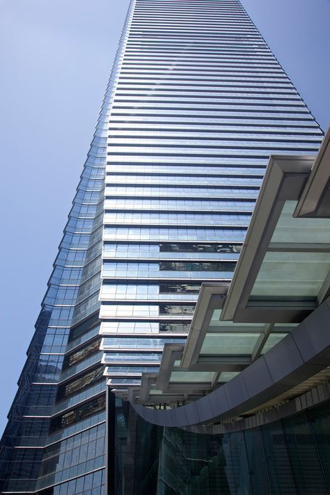 International Commerce Centre in Hong Kong. The facade of the skyscraper, which curls down like a dragon's tail, is a combination of steel and silver highly reflective glass with low-emissivity properties.