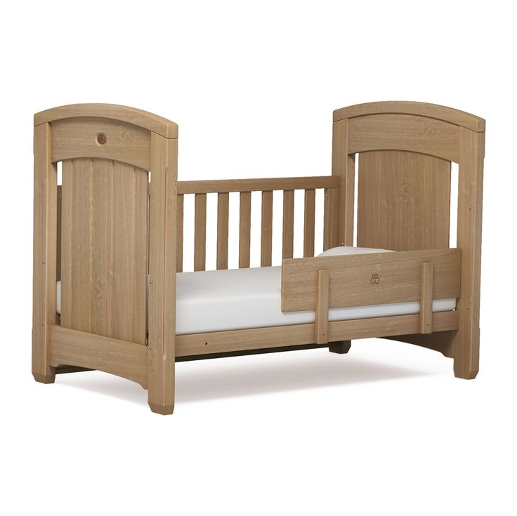 The evolution of the Boori Classic into the Boori Classic Royale Cot Bed, with partially solid ends.  Shown here with the toddler bed panel. | Available in almond or white.  | £499.00 from www.mollyandboo.co.uk | Nursery furniture, childen's bedroom | #baby