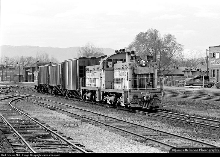 Union Pacific TR5 No. 1874 arrives at Provo Yard, returning from Hardy with three covered hoppers from Western Warehouse on April 24, 1976.