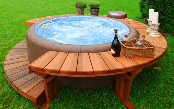 "20 Hot Tub Designs that are Heaven on Earth … if I ever get a hot tub; this could be a nifty design.  love the ""shelf"" for candles, glasses, etc."