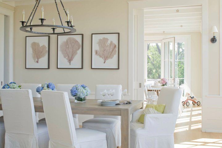Sunny beach cottage dining room with Benjamin Moore Sail Cloth walls, gray washed dining table, parsons chairs.