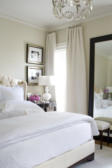 Amazing makeover: love the bed, nightstand, lamp, mirror, black + white photos, white + cream color scheme + drapes . For the guest room?Guest Room, Curtains, Bedrooms Design, White Beds, White Bedrooms, Master Bedrooms, Floors Mirrors, Benjamin Moore, Bedrooms Decor