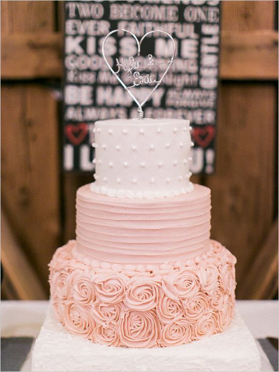 A romantic, white and rose colored wedding cake