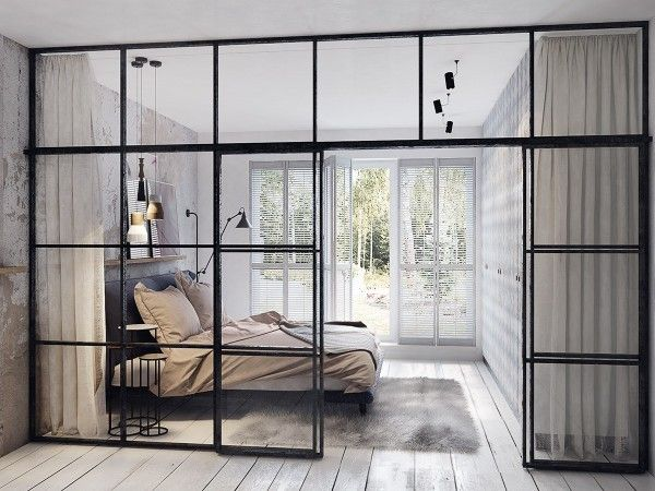 Biege bed in white bedroom with glass windows