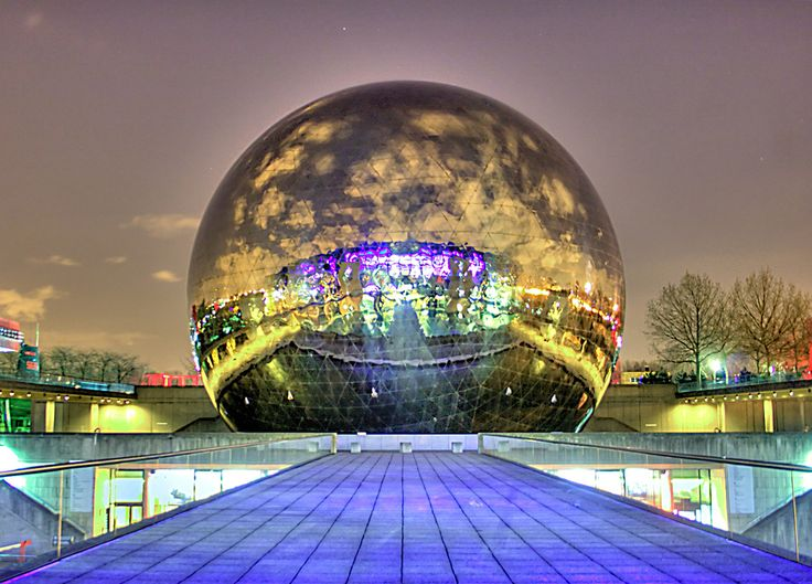 La Cité des sciences de l'Industrie in Paris, France. This science museum is not only the largest in Europe, but features La géode, a spherical theater that faces the museum and its reflecting pools.