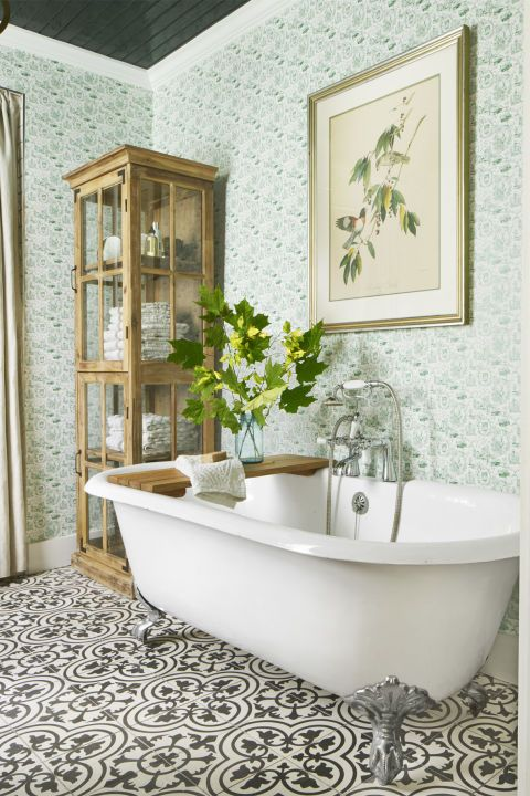 """The team gutted the room,enlarged the window, andelongated the shower, nowcovered with 3-by-6-inchwhite subway tile (LancasterBianco; tilebar.com), the piled on the pattern.""""Holly has a gift of mixingpatterns together,"""" says Page.Case in point: green toilewallpaper + a graphicblack-and-white tile. Thesmall scale of the playful toile doesn't fight with the floor. Ceiling Paint:Black Blue by Farrow& Ball. Trim: A..."""