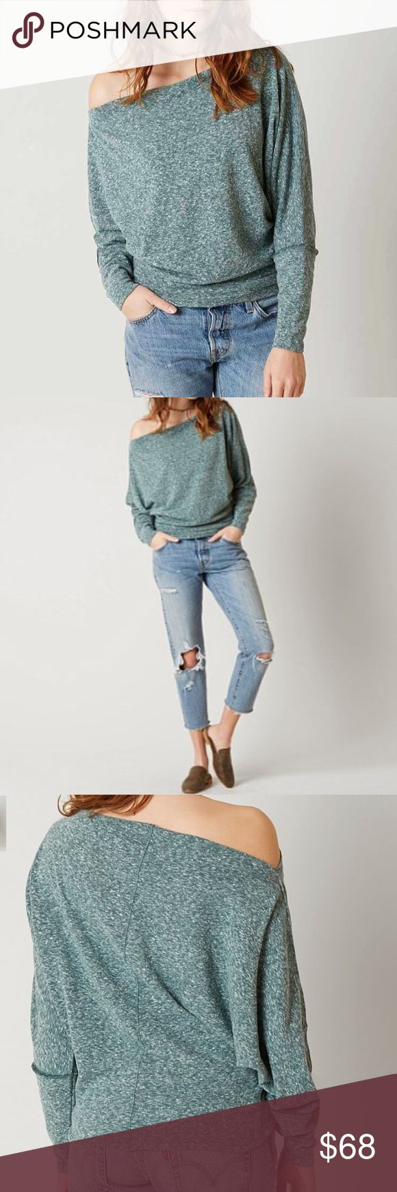 """FP FREE PEOPLE VALENCIA OFF THE SHOULDER TOP TEAL ITEM IS BRAND NEW WITH TAGS   Simple and virtually seamless, Free People's heathered jersey knit has a wide bateau neckline you can wear on the shoulders, as well, for a more draped effect in front.  DETAILS: Fits large Designed for a loose fit Bateau neck, off-the-shoulder design, three-quarter dolman sleeves, pullover style Approx. Center front length 26"""" Polyester/cotton Machine wash Imported Free People Tops Blouses"""