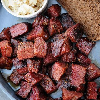 Use corned beef to give your burnt ends a little kiss of the Irish 😘🍀 I smoked a corned beef brisket point on my @firecraftbbq pellet and then braised the little nuggets in a reduction of @newcastle_brown_ale. Recipe at girlscangrill.com. #girlscangrill #cornedbeef