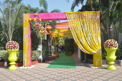 floral entrance decor, genda flowers, lime green flower pots, pink and yellow, day mehendi, bright, summer , colorful