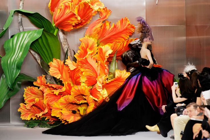 British set designer Michael Howells designed this dramatic parrot tulip set for Dior's Fall 2010 couture show. Best-Dressed Fashion Show Sets, Architectural Digest.