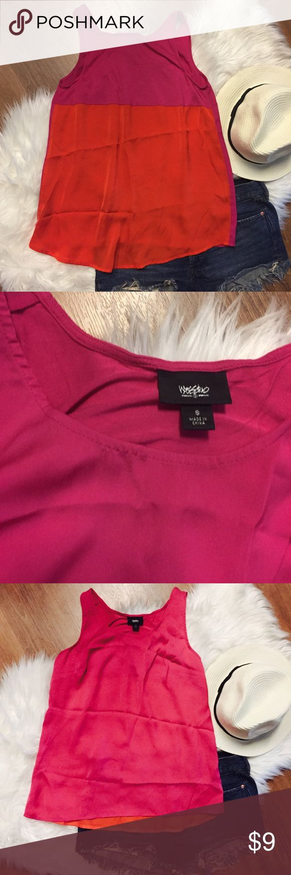 Colorblock Tank Top Mossimo Pink and orange Colorblock tank top - back is slightly longer than front. EUC in perfect condition- no signs of wear! Has always been washed according to care instructions and hung to dry. Wrinkled from being in drawer but ironing or steaming will easily remove these wrinkles! ✨ Bundles discounted! Reasonable offers accepted! MAKE ME AN OFFER Mossimo Supply Co. Tops Tank Tops