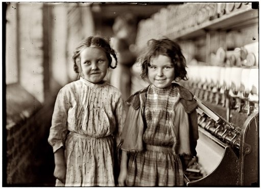 "1909 - Two of the ""helpers"" in Tifton Cotton Mill at Tifton, Georgia. They work regularly."