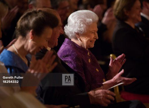 Queen Elizabeth II, the Duke of Edinburgh (centre) and the Princess Royal (left) listen to poetry readings during a Reception for Contemporary British Poetry at Buckingham Palace, London.