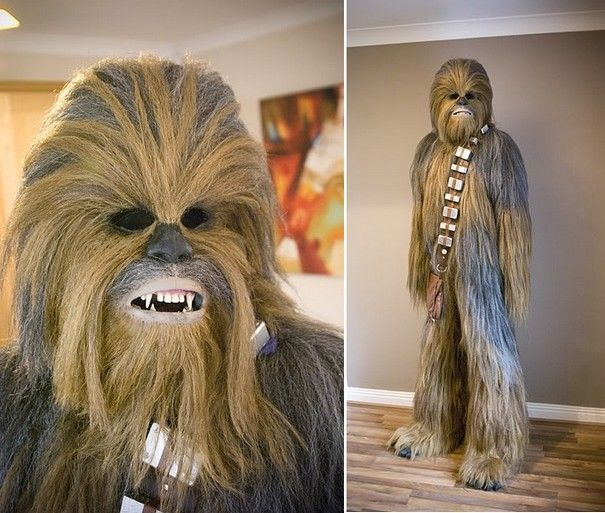 "WOW! This is *homemade*! Incredible! The article links directly to the forum post where the guy describes how he did it, but it'll wonk on you. But if you go to the forum home page, then go to the ""Star Wars Costumes"" section, you'll find the thread, called ""Chewbacca"", started by Dougie Fett. You should go read it, it's really cool! He even made himself taller: he's 5' 11"" outside the costume, and 7' 1"" in it!"