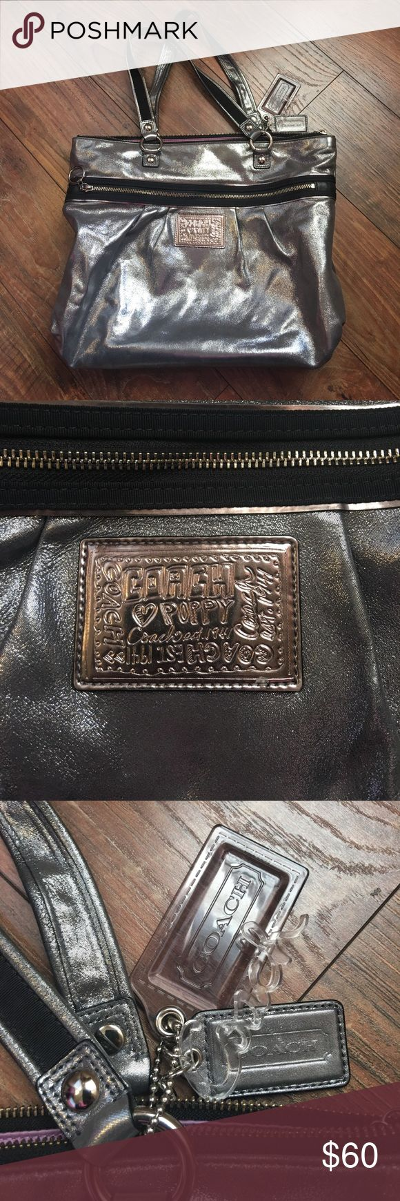 Coach silver tote bag EUC Coach silver tote bag EUC. Tony spot on the back. See photo. 16x13x4.5 inches. 100% authentic. No holds or trades. ❤️❤️❤️ Coach Bags Totes