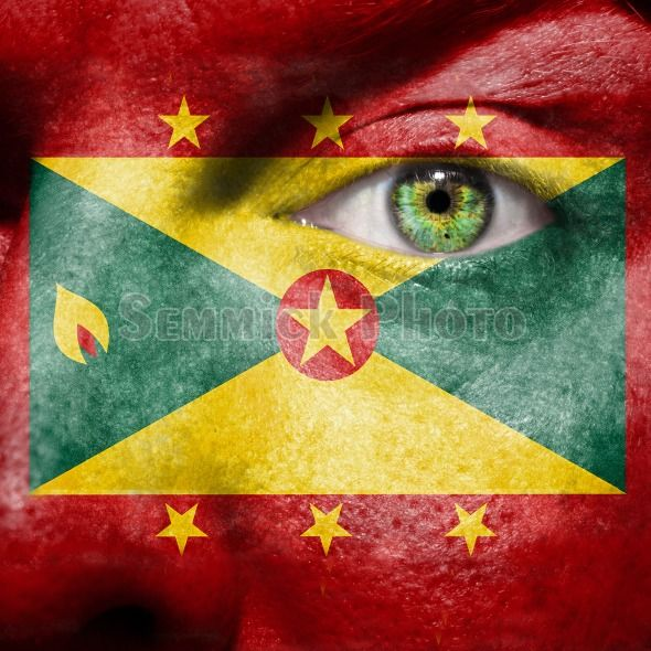 Grenada flag painted on a face | Grenada flag painted on a man's face with a green eye to show ...