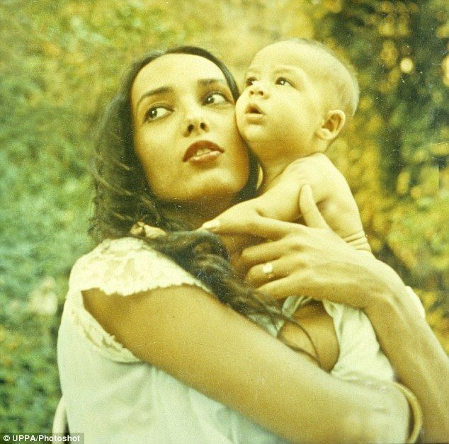 Tender moment: Anna, who passed away in Washington state, is seen cradling her son, Christian, as a baby