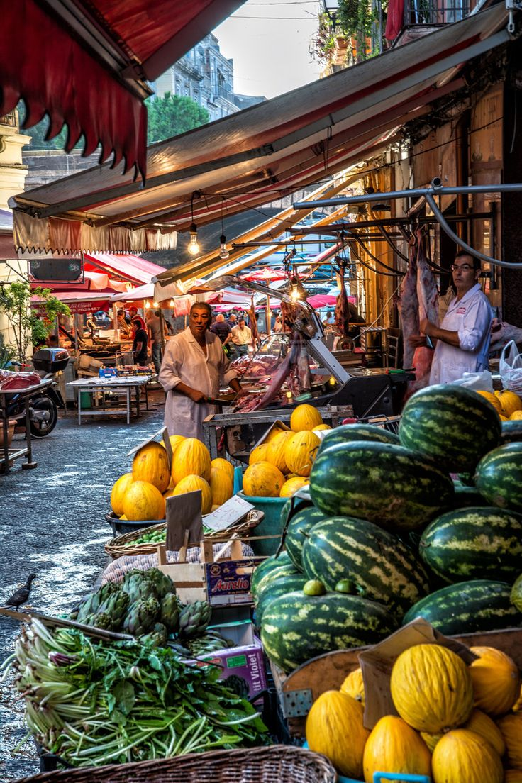 Catania Market, Sicily, Italy ~ Sicily simply charms its visitors: the city Palermo, strongly influenced by the Arab and Norman civilizations, the Greek ruins of Agrigento and Syracuse, the seven Aeolian Islands home to lush vineyards and luxury hotels, the beaches of Taormina, and a delicious local cuisine.