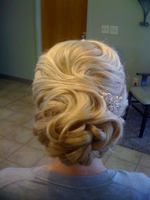 Vintage wedding hairstyle. I like the look from the back, maybe with some face framing curls in the front. Not sure how to incorporate the headpiece.