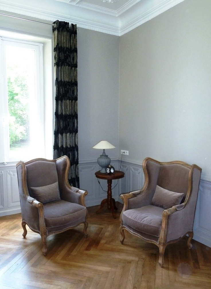 Warm French Greys wash the walls of Chateau La Perriere in the Loire Valley
