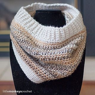 The Riverbed Cowl is a simple design that utilizes two different types of yarn - a bulky tweed and a worsted solid. It is a match to the Riverbed Slouch Hat, which can be found at: