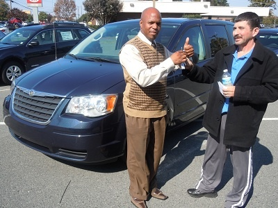 Folger Subaru Sales Consultant Andre Clark with Mr. Galicia and his 2008 Chrysler Town & Country minivan!