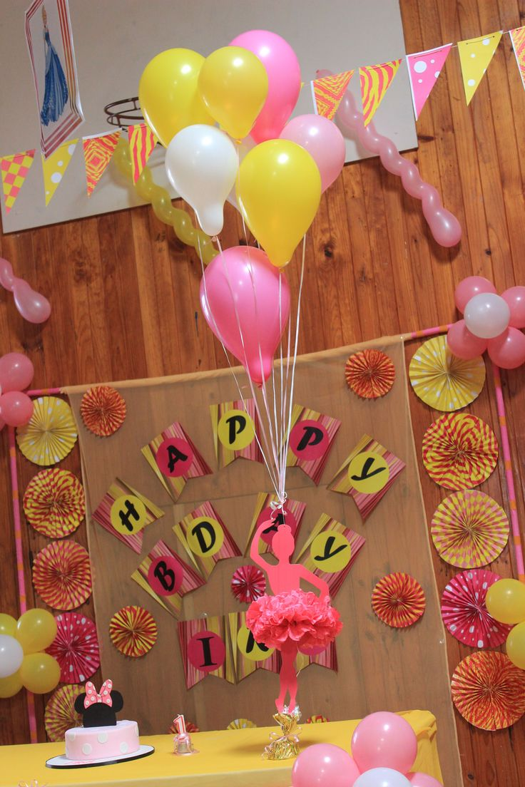 Another unique addition to the decoration was the pom pom doll and number '1' cut-out hanging from helium balloons.