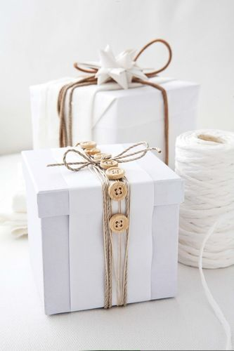 Simple white packaging with button and twine trim.