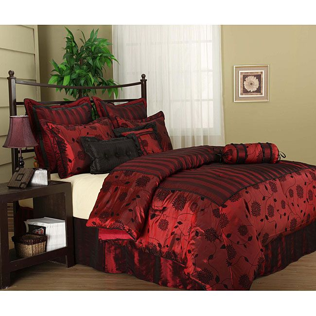 Add elegance and beauty to any bedroom with this complete luxury comforter set. Its rich red fabric delights the eye and will coordinate with a variety of other colors. The set comes complete with comforter, neckroll, bedskirt, shams, and two pillows.