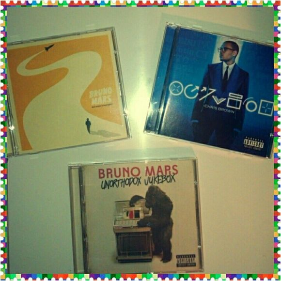 Bruno Mars and Chris Brown CD 2 Bruno Mars CDs and 1 Chris Brown CD. They were each 15$. I will take offers Other