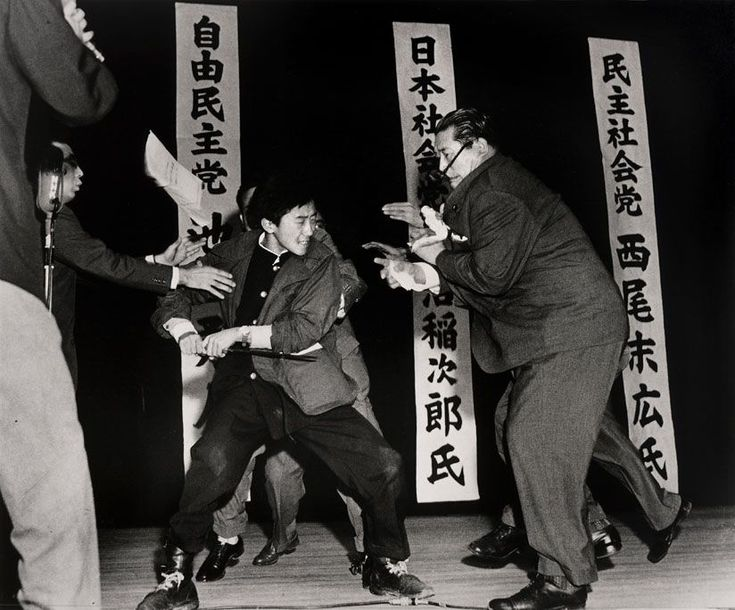 19 - Using a traditional Japanese blade 17-year-old Otoya Yamaguchi assassinates socialist politician Inejiro Asanuma in Tokyo Japa