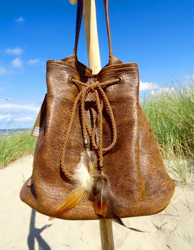 Handmade bag with feathers in bohemian gypsy style.