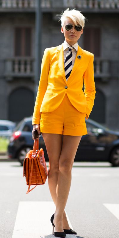 Esther Quek in orange short suit set | Photo via http://theurbanspotter.com