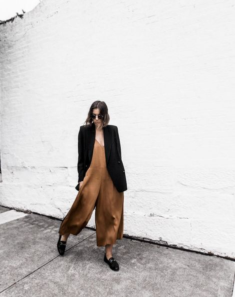 minimalist women's street fashion outfit // gold brown jumpsuit with black jacket