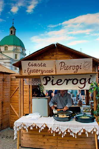 pierogi vendor, Old Town, Warsaw, Poland. Family tradition on my dad's side on Christmas or nearby is to make homemade pierogis, it would be amazing to visit Poland someday and buy some in a town.
