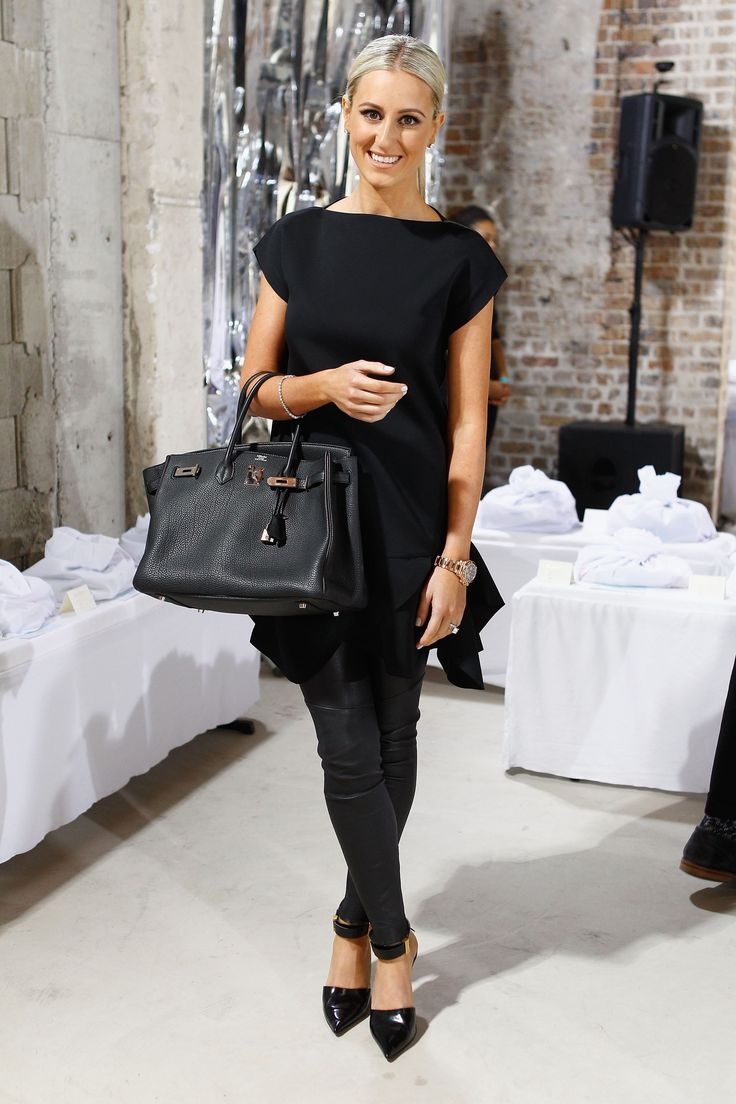 Roxy Jacenko wears a black top, black leather pants, pointed pumps paired with a Hermes Birkin