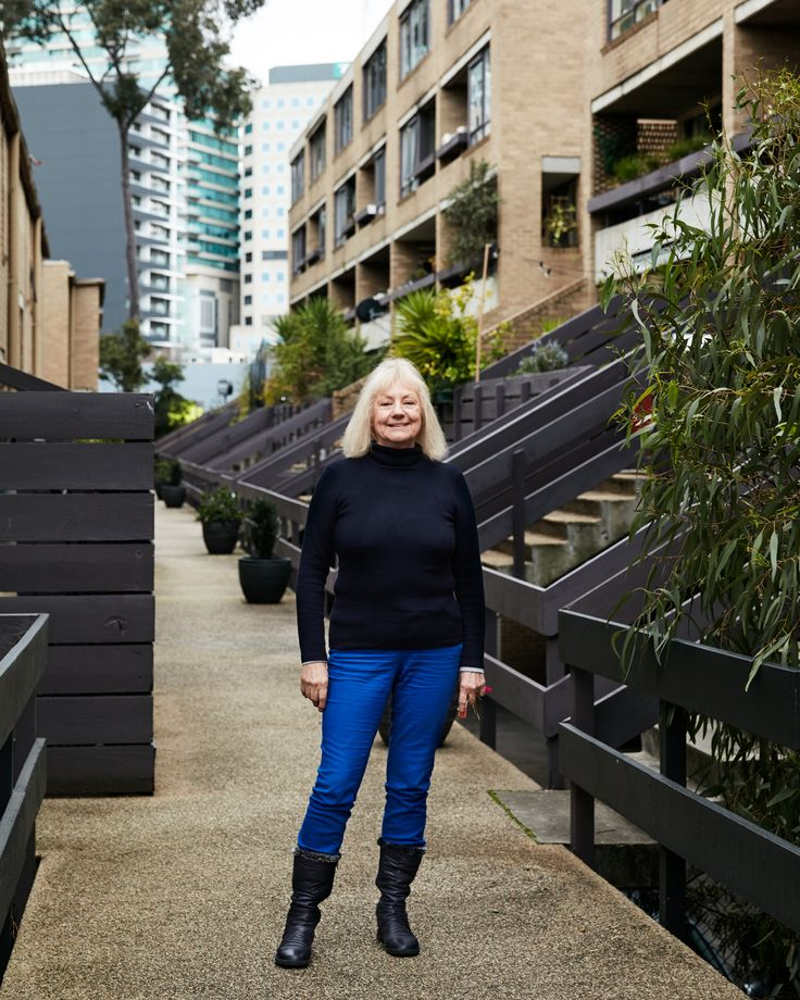 City Edge: Melbourne's Original Urban Village | Assemble Papers by Rachel Elliot-Jones. Resident Jan Boyd proudly standing atop the raised pathway that leads to her front door. Photo by Tom Ross.