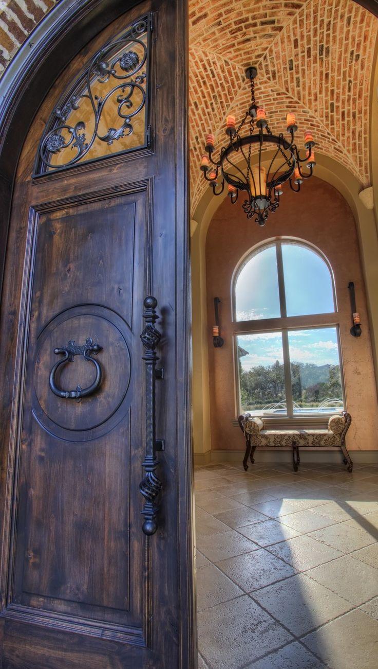Heavy wooden entrance door with wrought iron candleabra in hallway & 95 best Front Doors images on Pinterest | Front doors Door entry ...